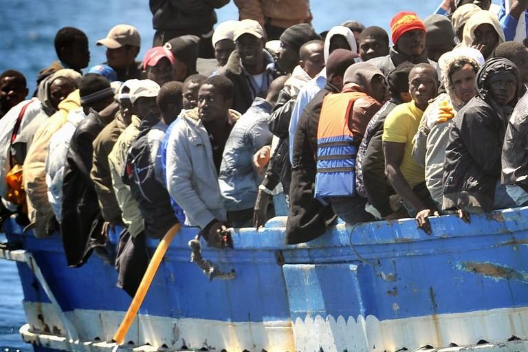 Immigrati su un barcone